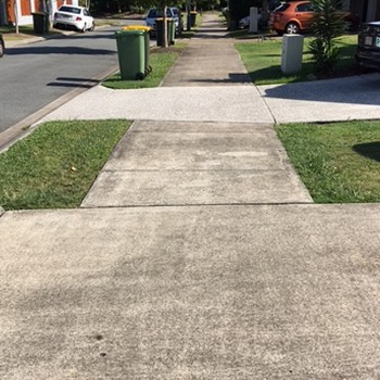 Before the driveway pressure cleaning services for a Sunshine Coast home.